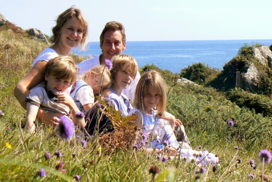 family on coastal footpath
