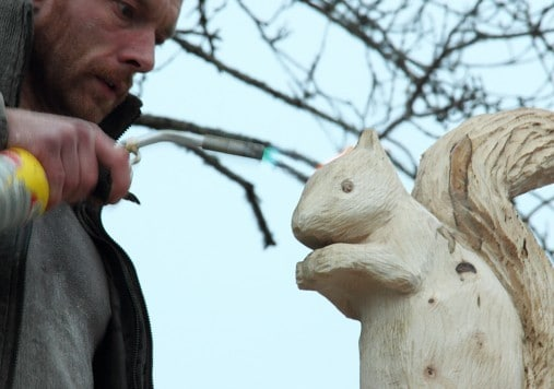 Matt Crabb the UK chainsaw carving champion at work on ...