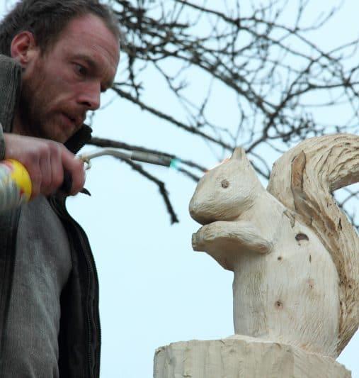 German shepherd chainsaw carving wood year of clean water