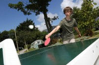 Boy playing ping pong / table tennis