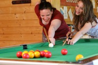 mother and daughter playing pool