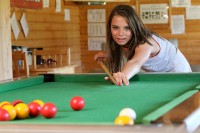 Girl playing pool